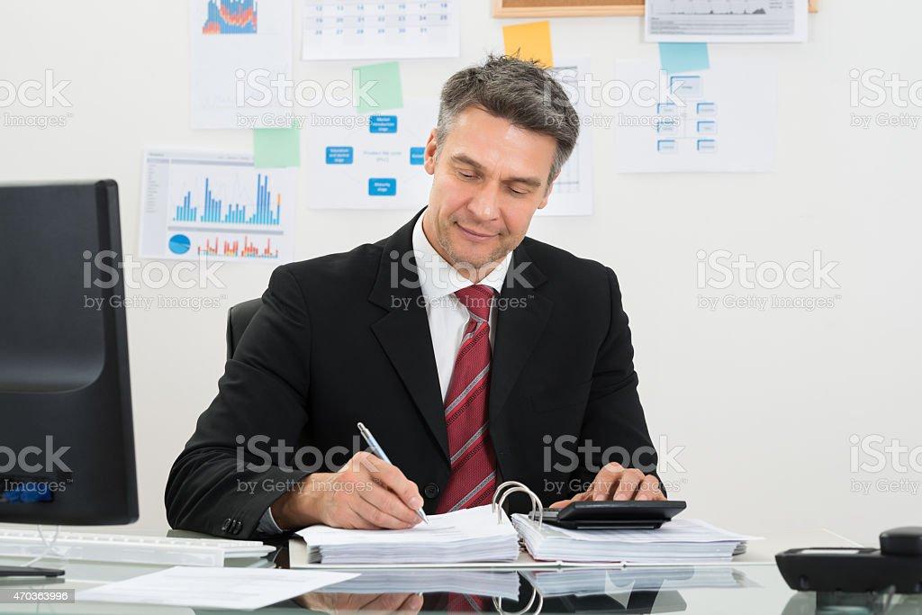 Businessman Calculating Finance stock photo