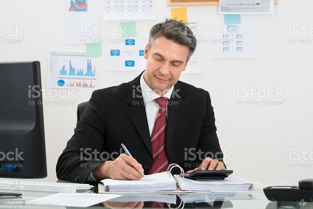 Businessman Calculating Finance stock photo