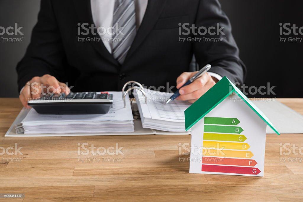 Businessman Calculating Financial Data stock photo