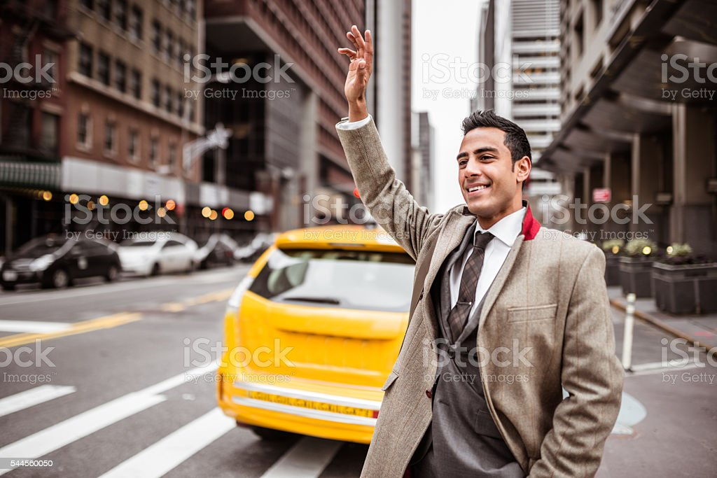 Businessman calling a taxi in new york city stock photo