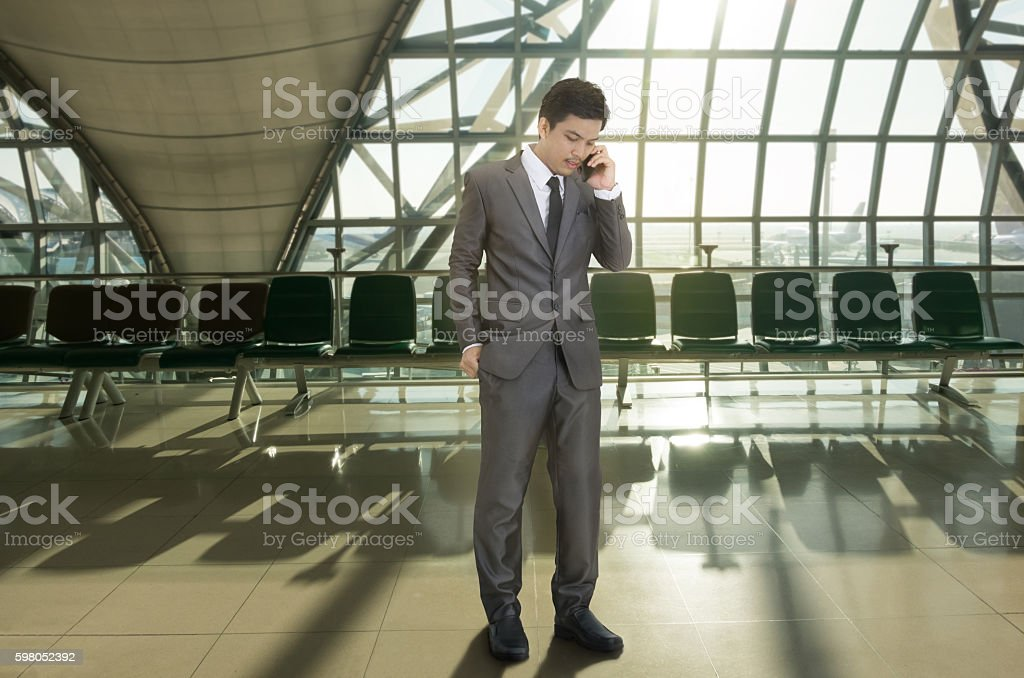 Businessman calling a telephone in terminal airport stock photo