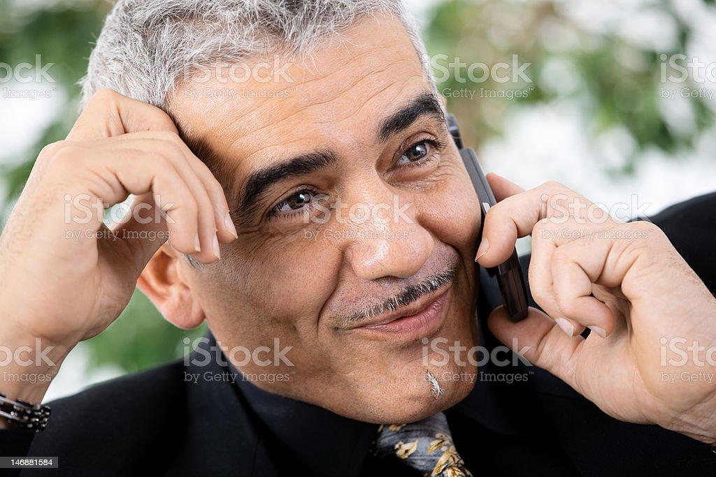 Businessman calling on phone royalty-free stock photo
