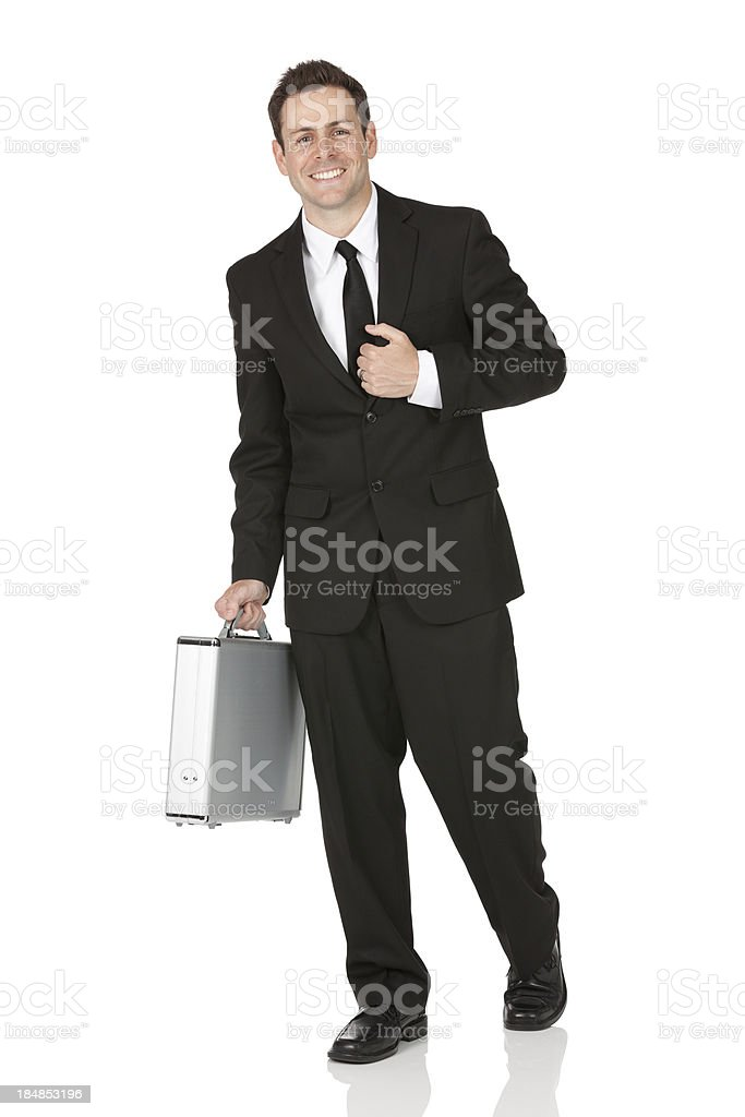 Businessman carrying a briefcase royalty-free stock photo