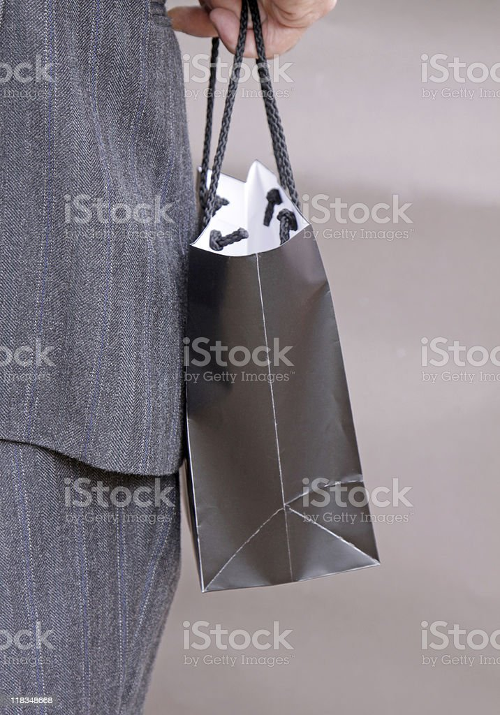businessman carrying a giftbag royalty-free stock photo