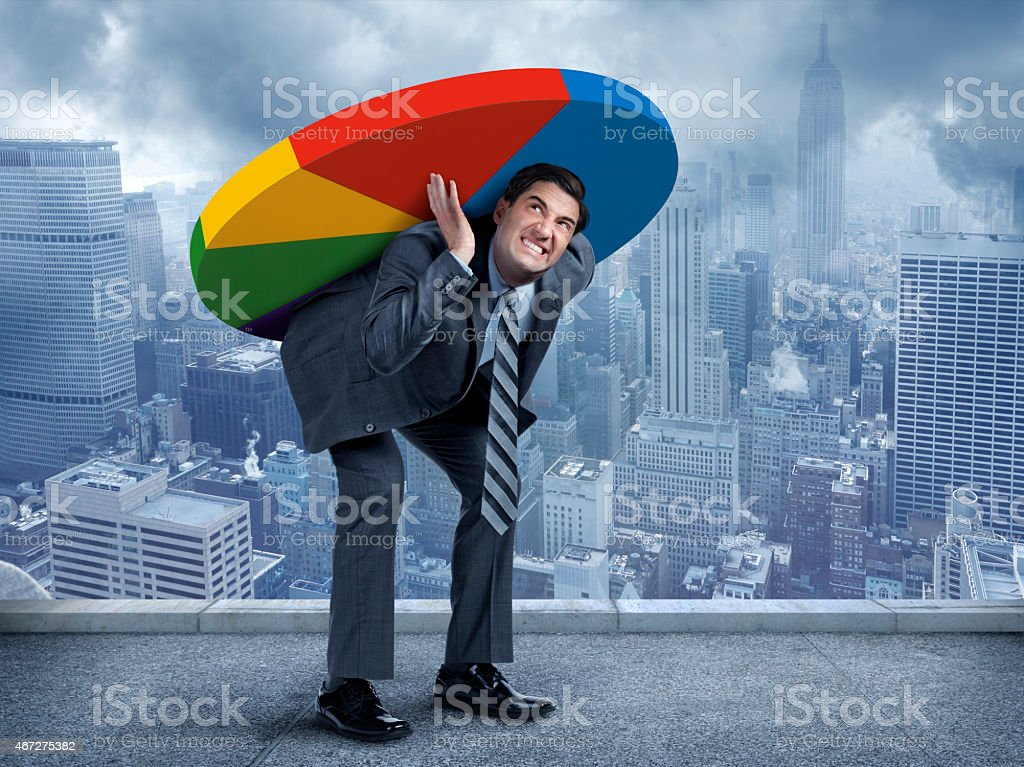 Businessman Carrying A Pie Chart On His Back stock photo