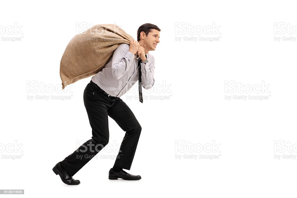 Businessman carrying a sack stock photo