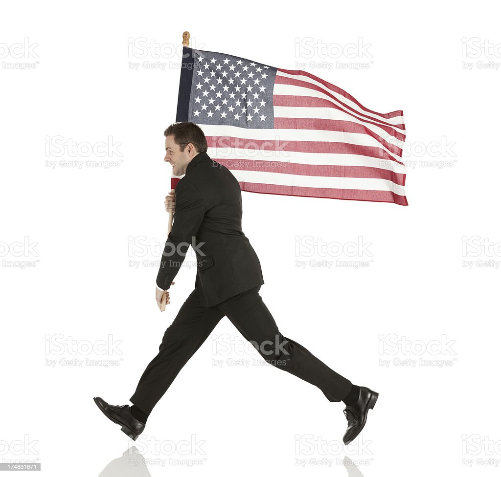 Businessman carrying an American flag royalty-free stock photo
