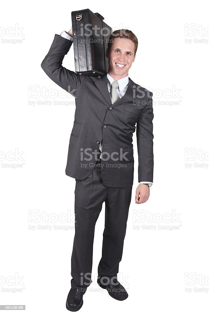 Businessman carrying briefcase on shoulder stock photo