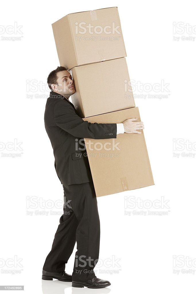 Businessman carrying cardboard boxes royalty-free stock photo