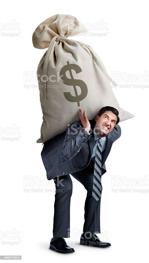 Businessman Carrying Large Money Bag stock photo