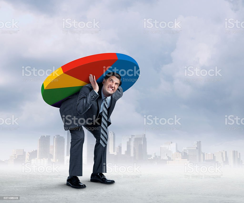 Businessman Carrying Pie Chart On His Back stock photo
