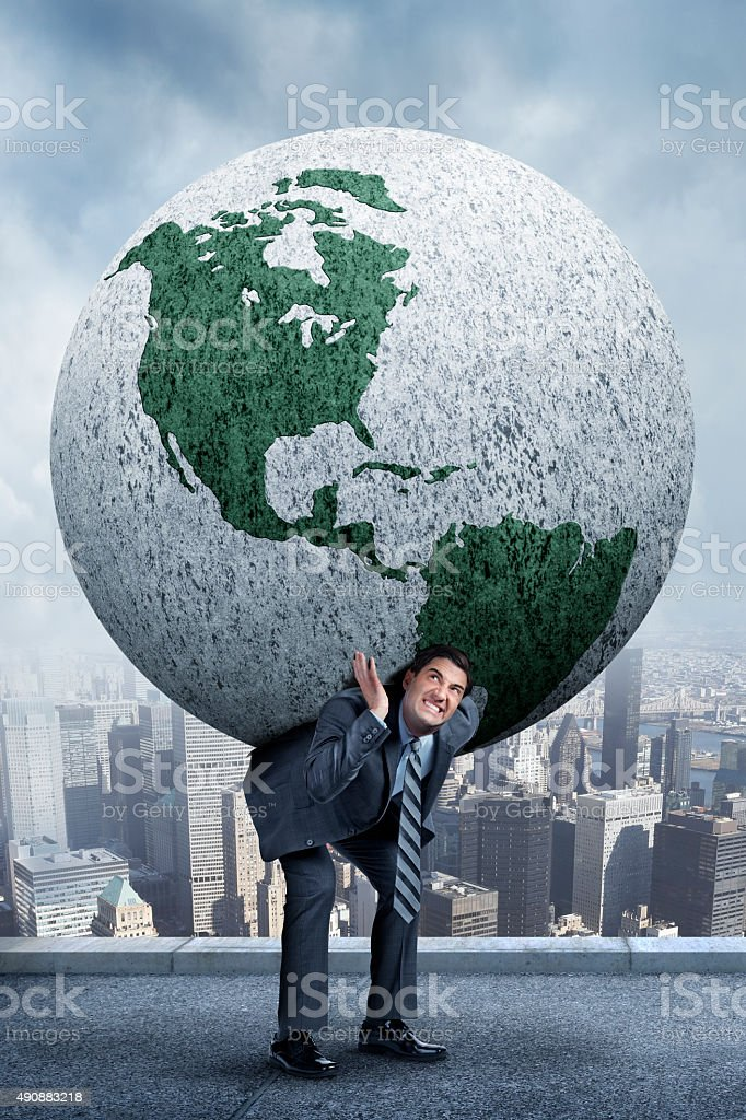 Businessman Carrying World On His Back stock photo