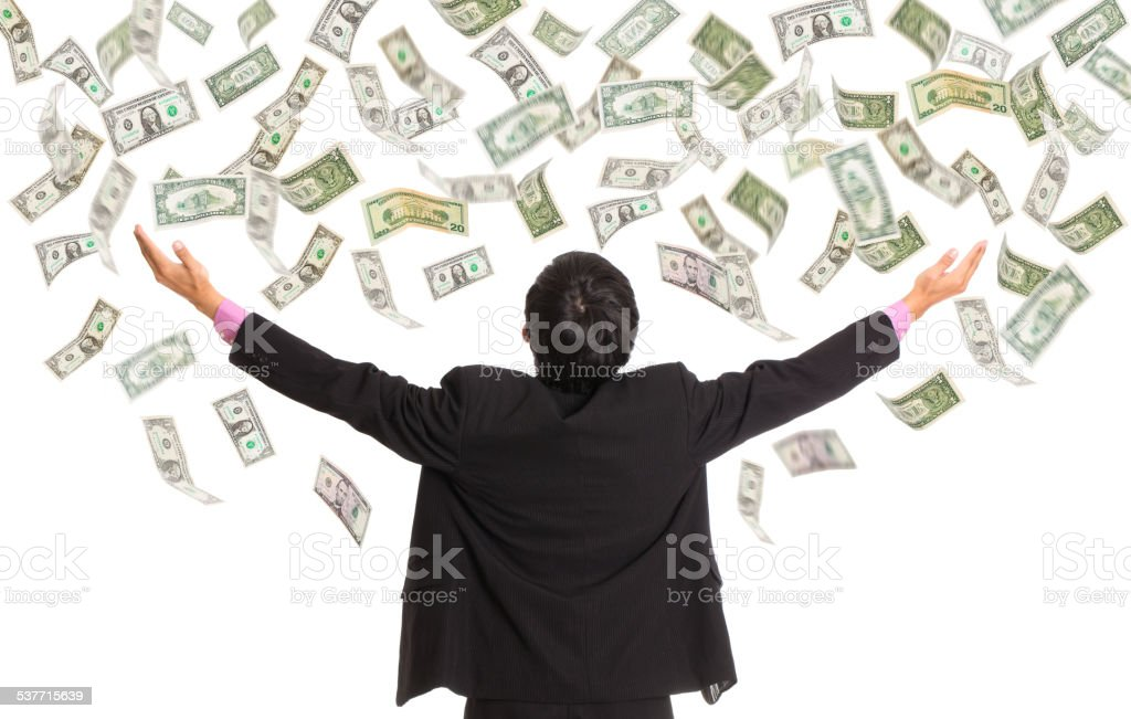 Businessman catching money with open arm stock photo