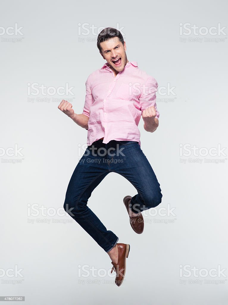 Businessman celebrating his success and jumping stock photo