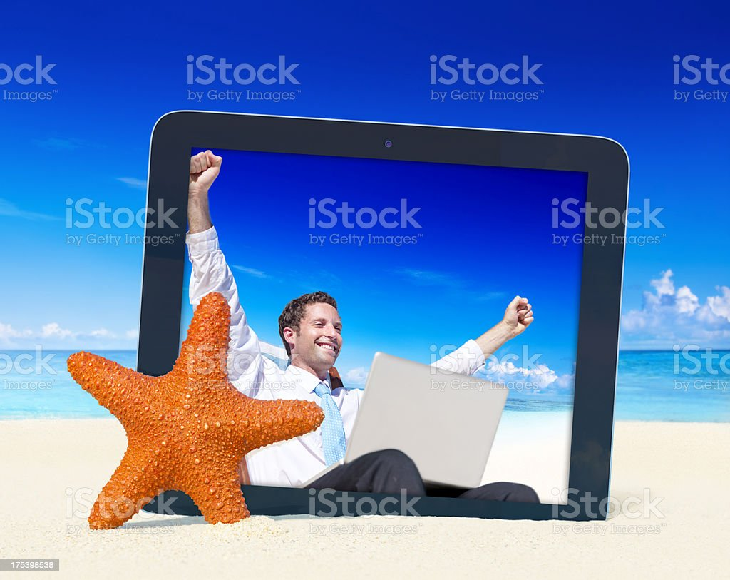 Businessman Celebrating on the beach royalty-free stock photo