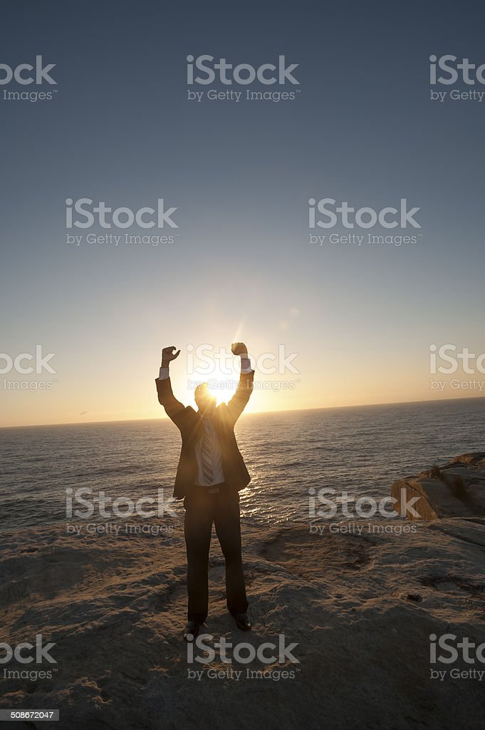 Businessman celebrating with arms up stock photo