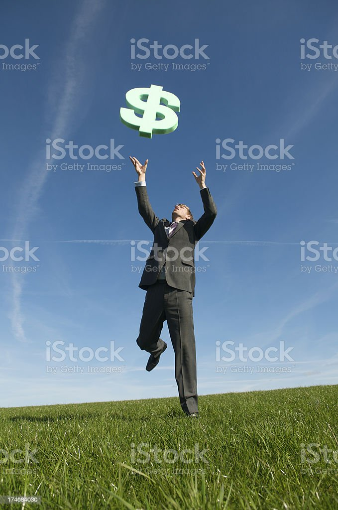 Businessman Chases Dollars in the Sky royalty-free stock photo