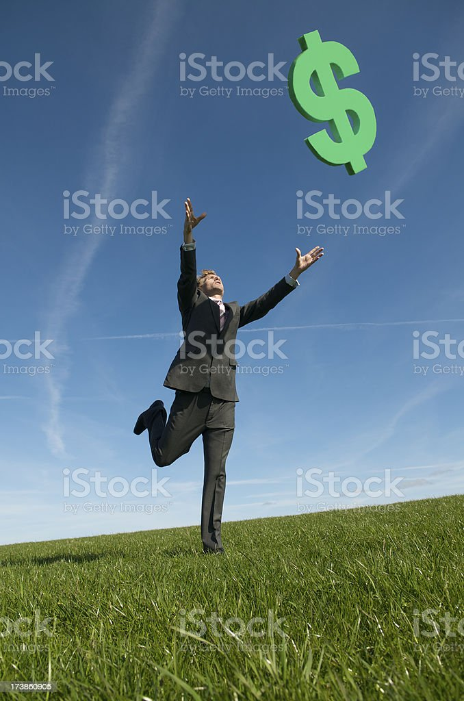 Businessman Chasing Green Dollar Sign Falling from Sky royalty-free stock photo