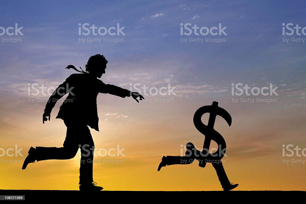 Businessman chasing money stock photo