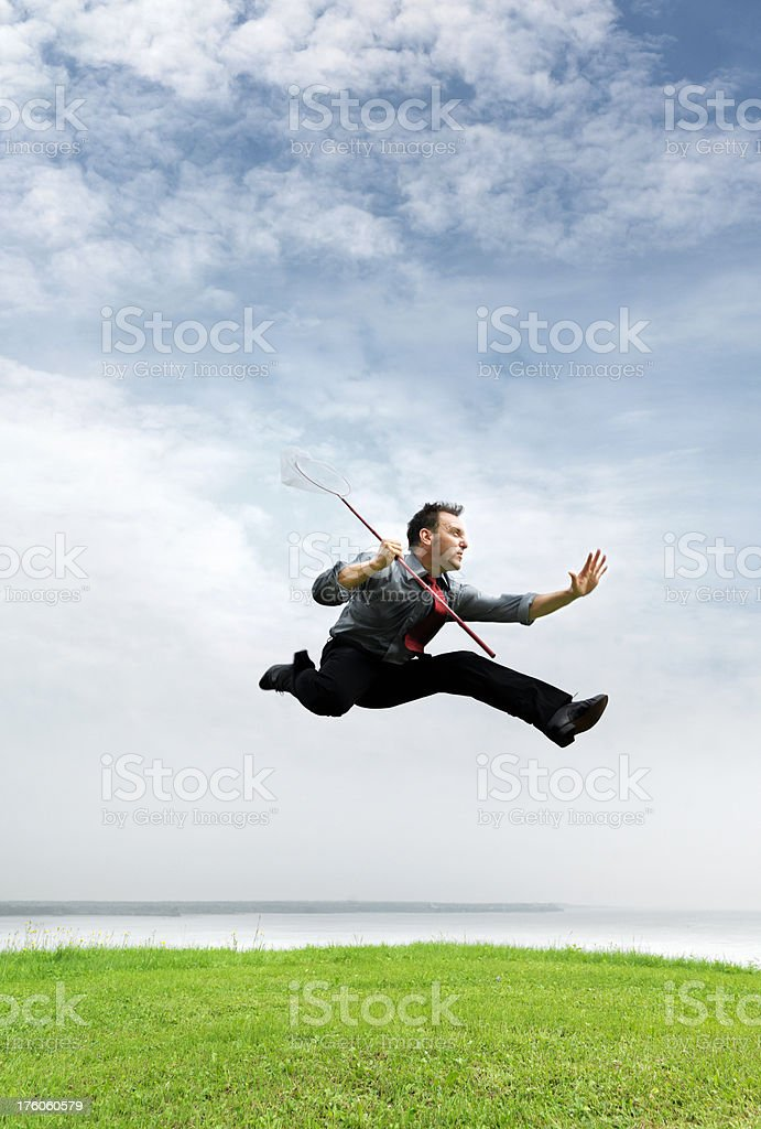 Businessman chasing royalty-free stock photo
