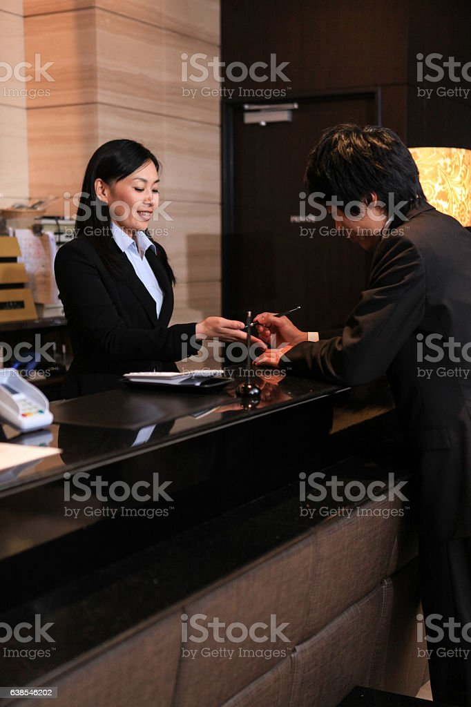 Businessman check-in Hotel Reception in Tokyo stock photo