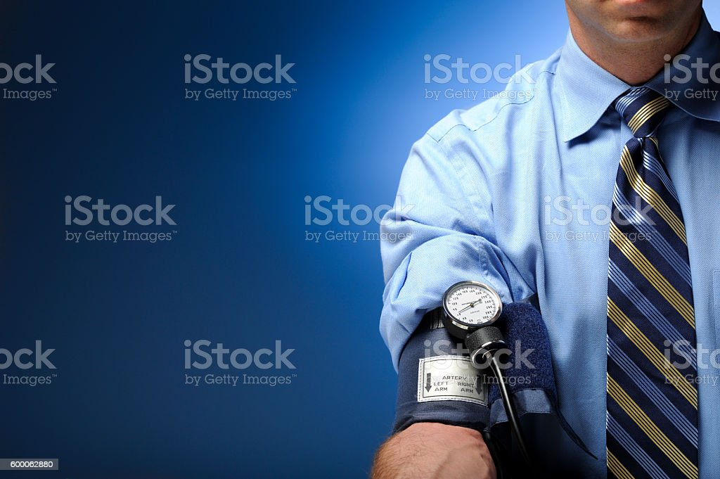 Businessman Checking Blood Pressure stock photo