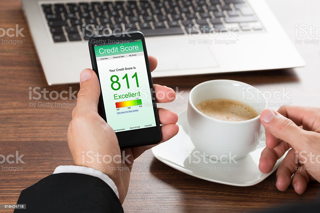 Businessman Checking Credit Score On Cellphone stock photo