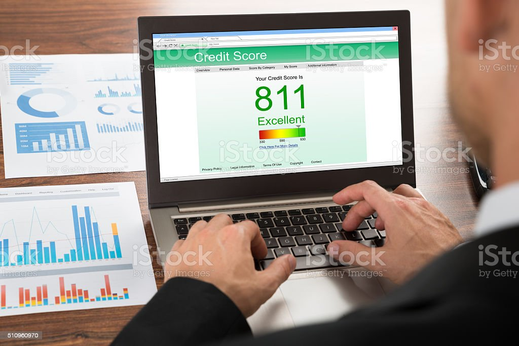 Businessman Checking Credit Score stock photo
