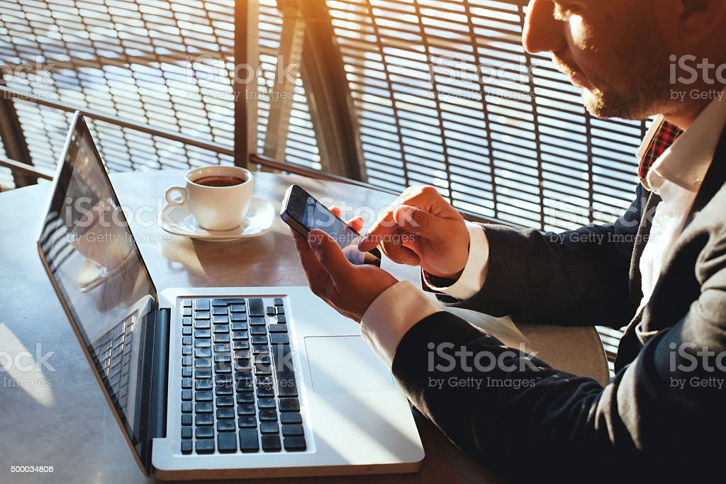 businessman checking email on smartphone stock photo