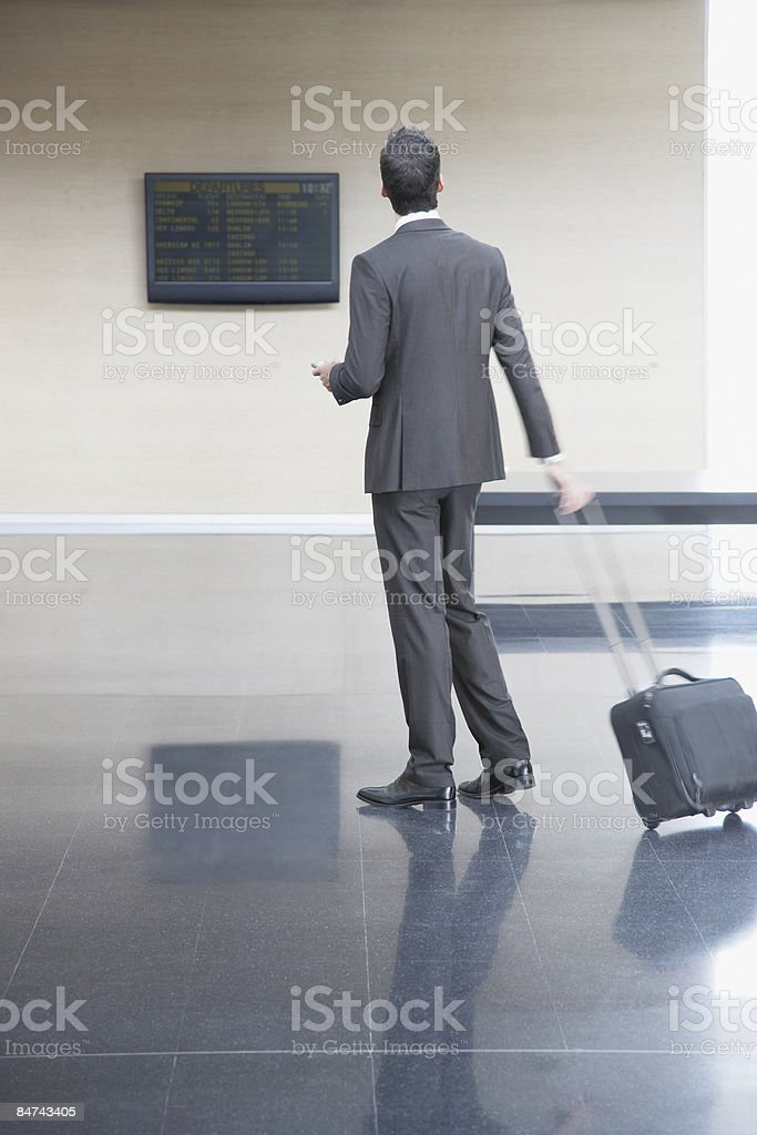 Businessman checking flight times stock photo