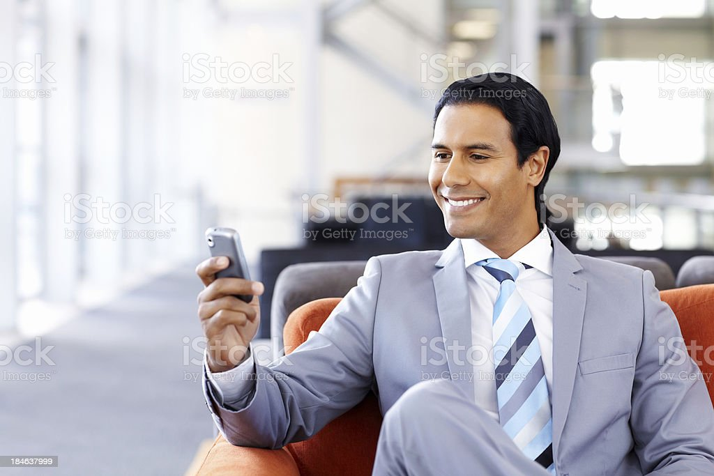 Businessman Checking His Cellphone royalty-free stock photo