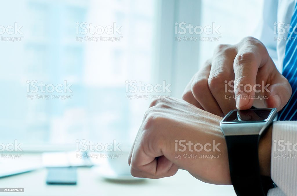 Businessman checking his smartwatch stock photo