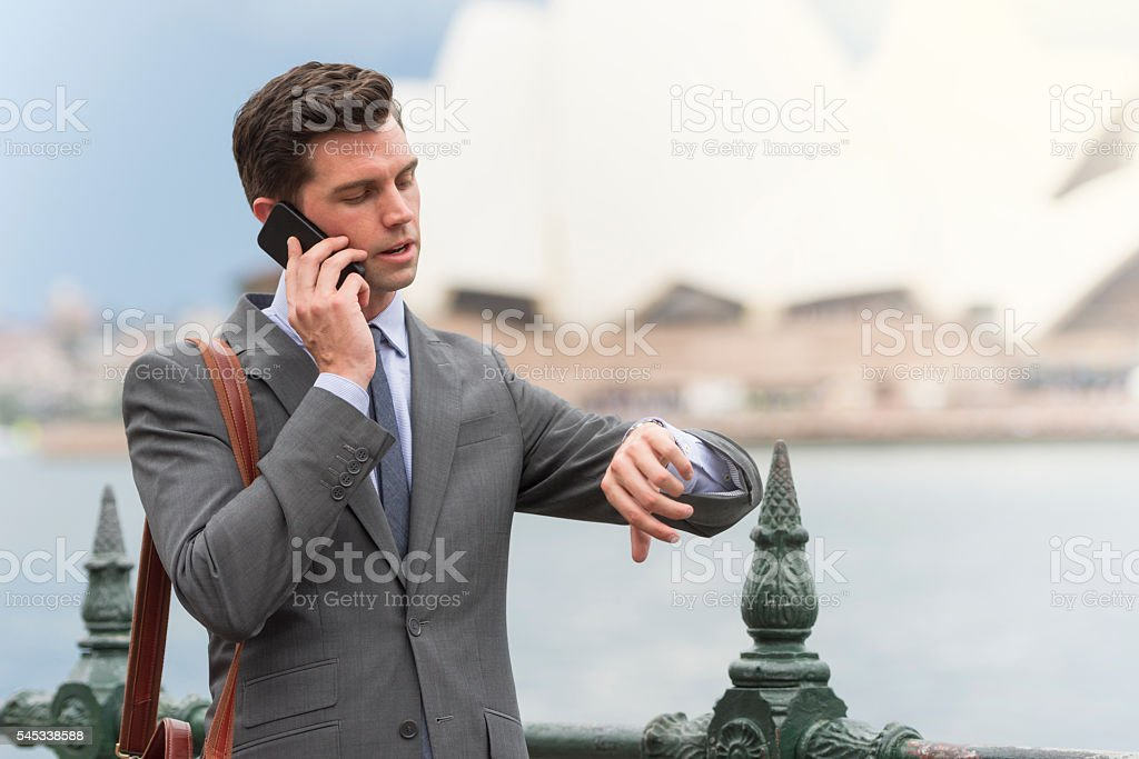 Businessman checking his watch stock photo
