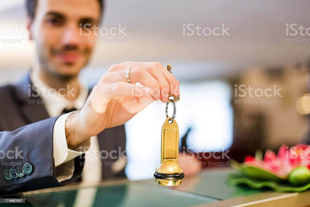 Businessman checking in to a hotel stock photo