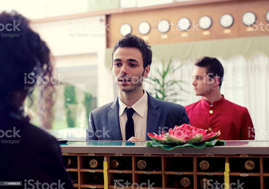 Businessman Checking in to hotel royalty-free stock photo