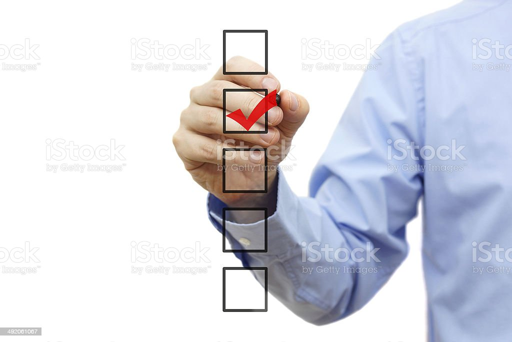 Businessman checking one of five black coxes stock photo