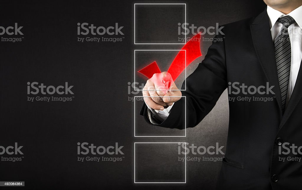 Businessman checking one of four white coxes stock photo