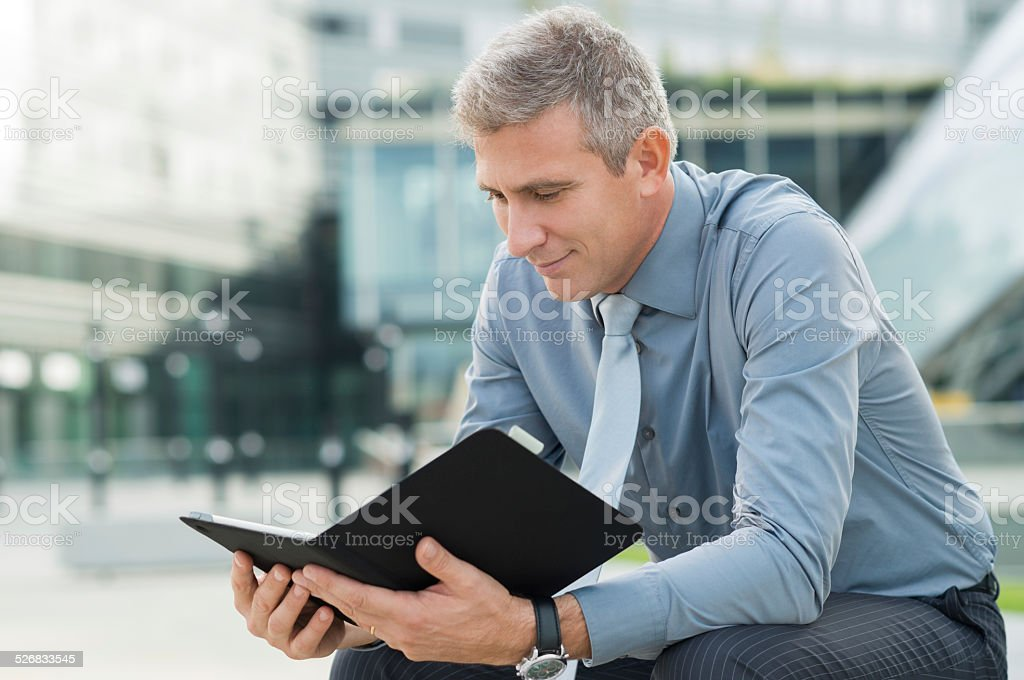 Businessman Checking The Mail Outdoor stock photo