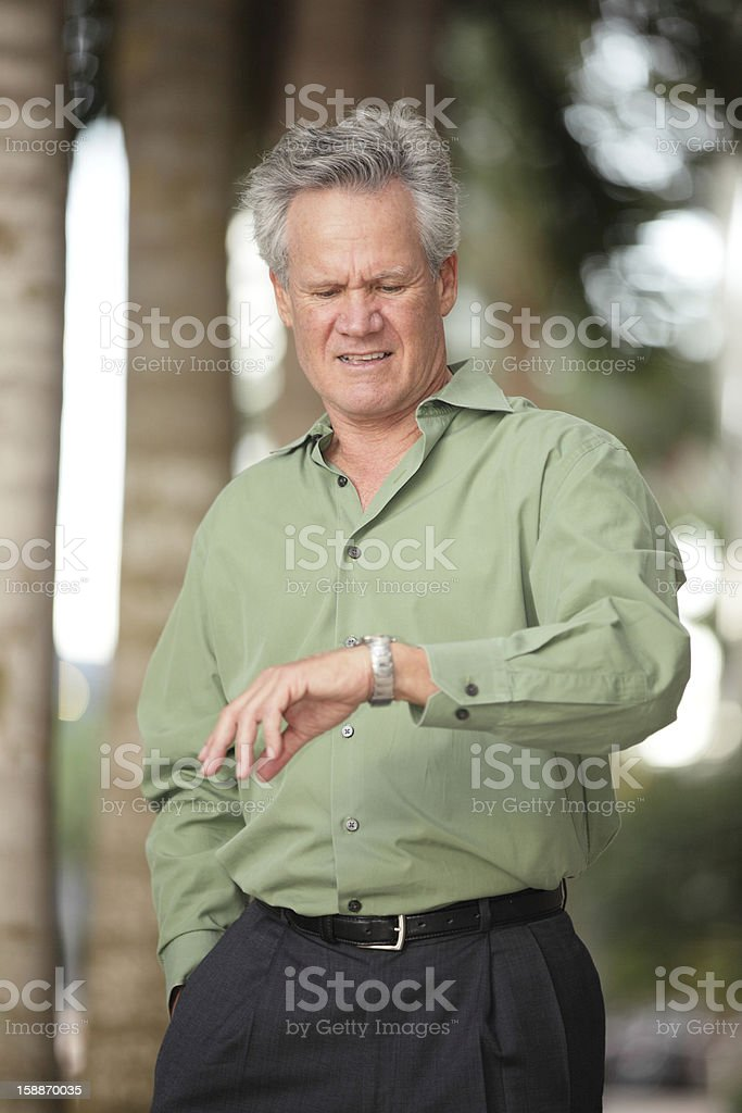 Businessman checking the time royalty-free stock photo