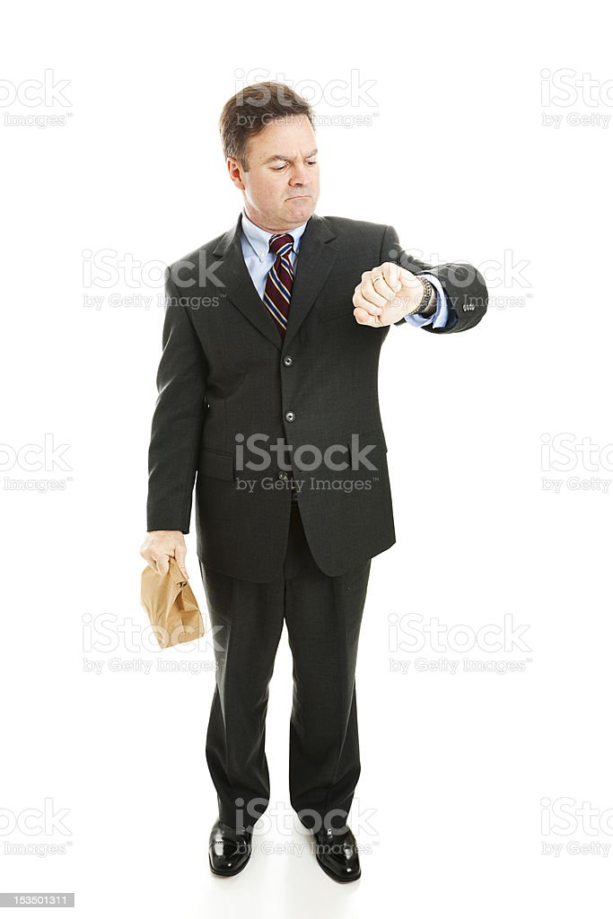 Businessman Checking Watch royalty-free stock photo