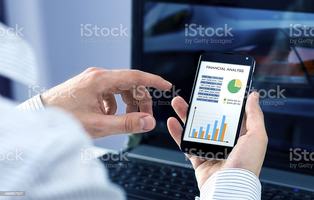 Businessman checks the financial analysis stock photo