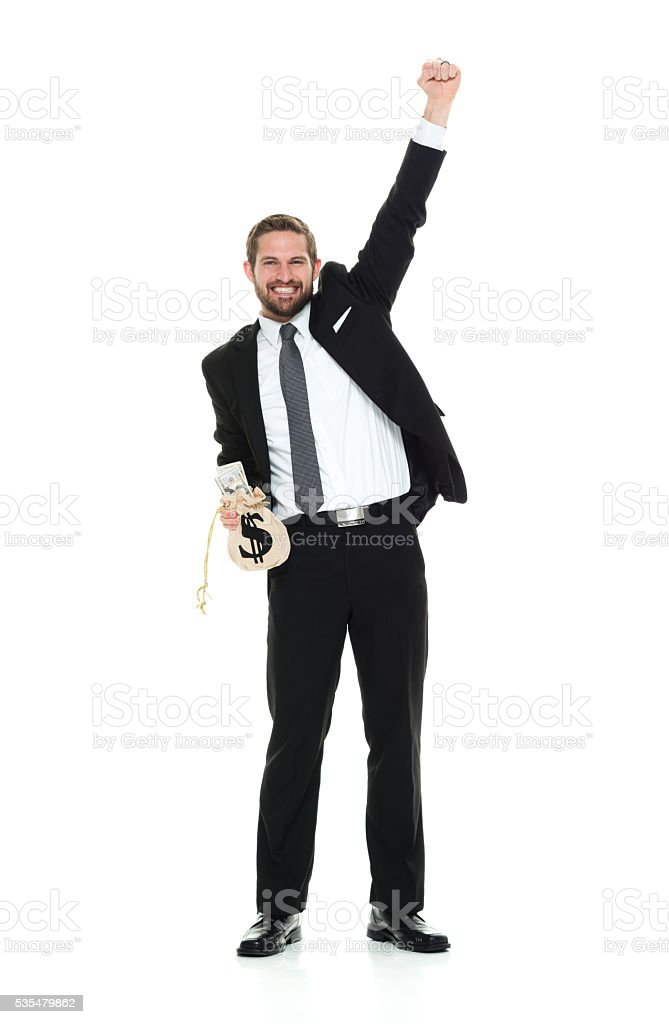 Businessman cheering with money bag stock photo