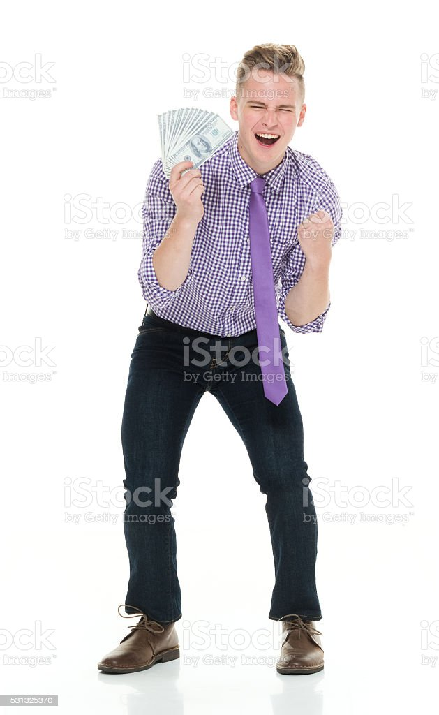 Businessman cheering with money stock photo