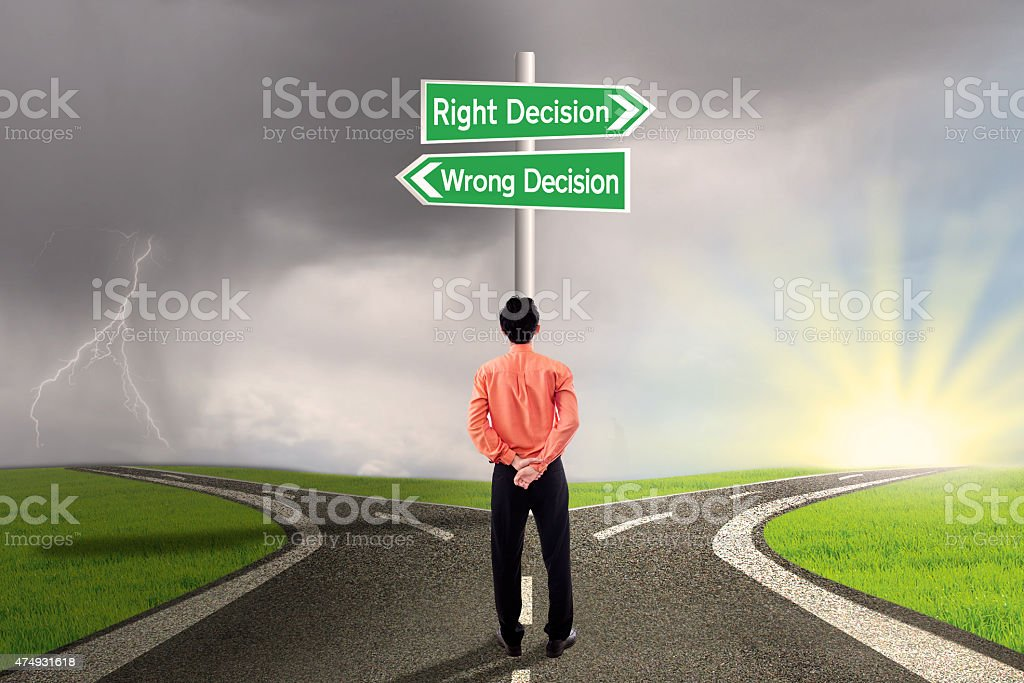Businessman choose right or wrong decision stock photo
