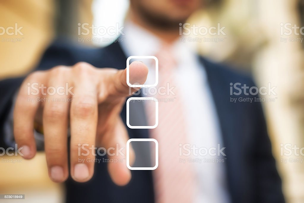 Businessman Choosing an Answer stock photo