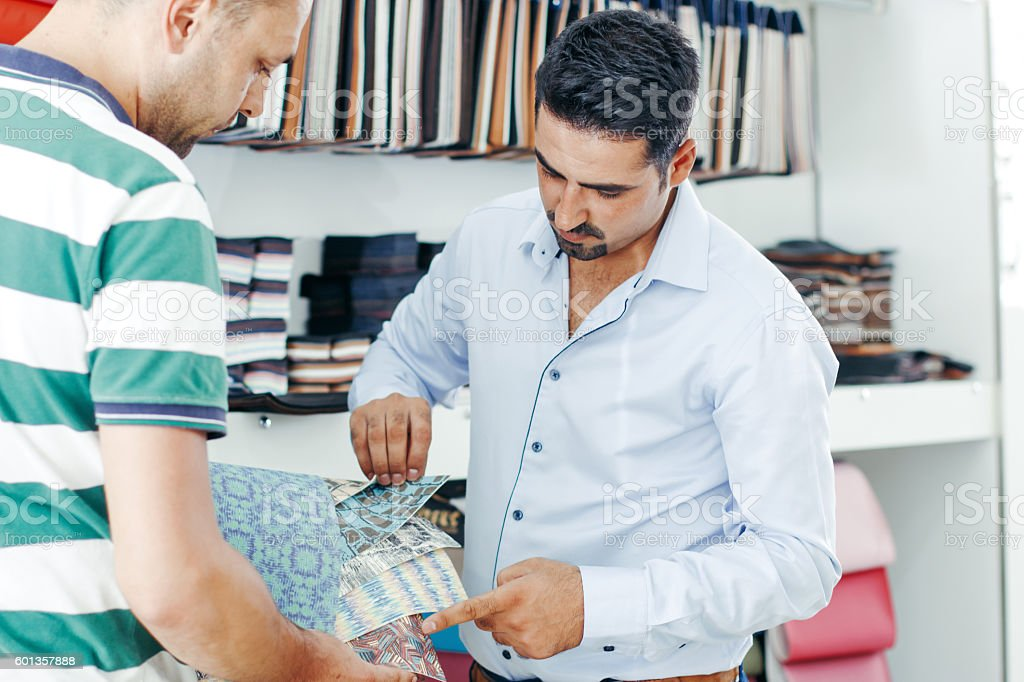 Businessman choosing artificial leather sample stock photo