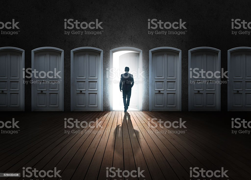 Businessman choosing door for the future stock photo