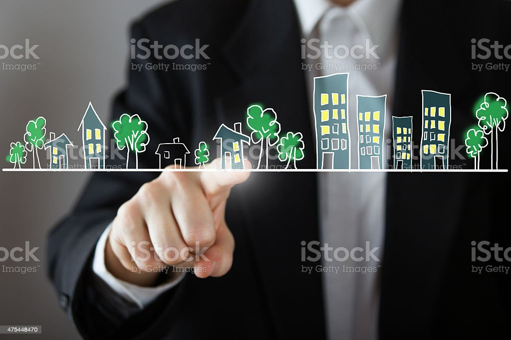 Businessman choosing house, real estate concept. stock photo