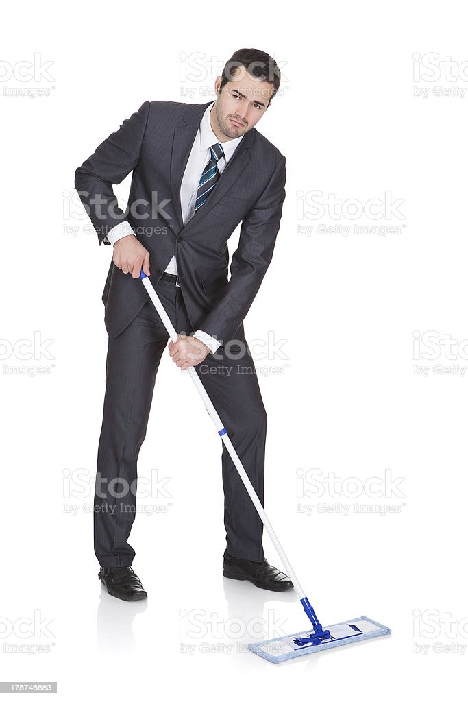 Businessman cleaning floor royalty-free stock photo