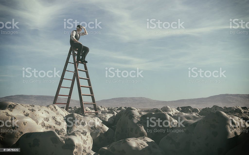 Businessman climbed on top of the stairs which can see stock photo
